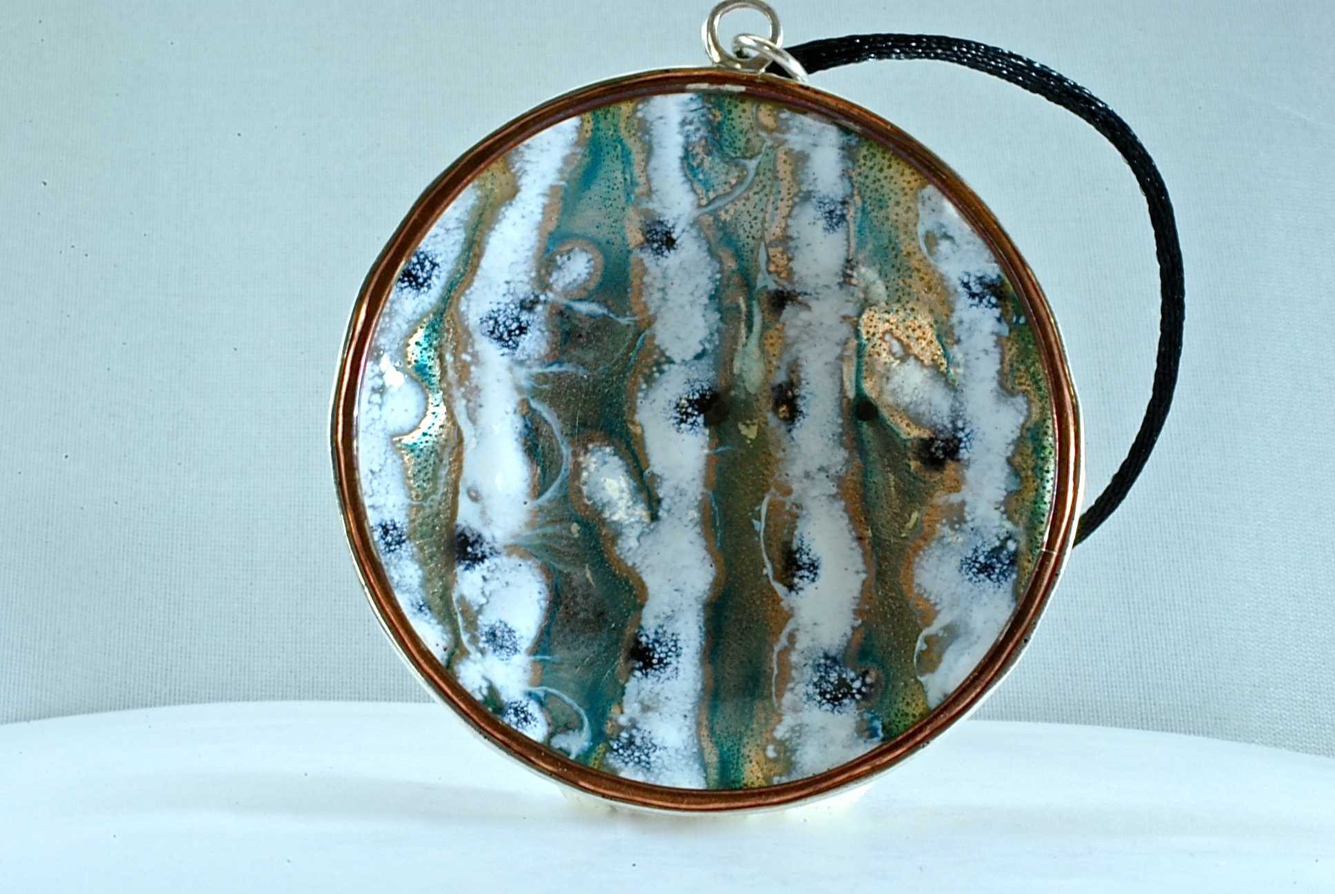 """""""Winter"""" 20mm enameled copper set in sterling silver two-sided pendant (see #14). 2017."""