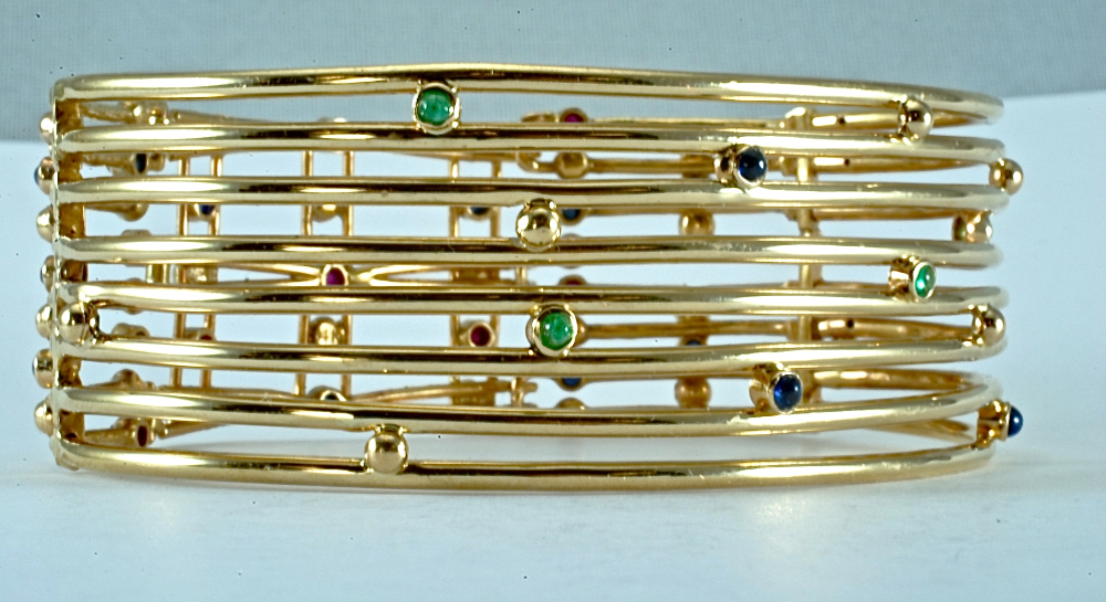 14kt yellow gold reversible bracelet set with 3mm cabochon emeralds, sapphires and rubies.