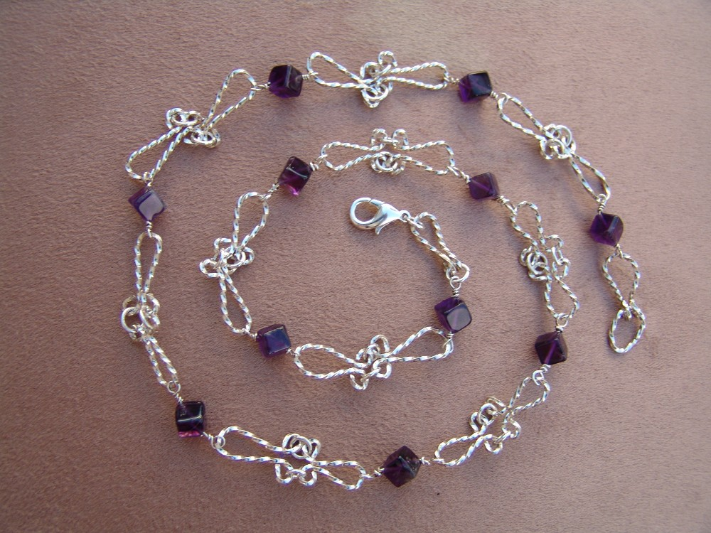 Square wire, hand twisted sterling silver necklace with amethysts