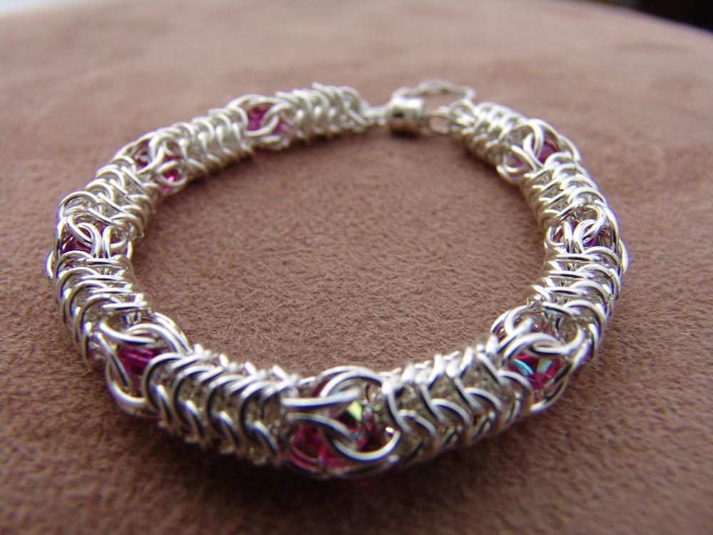 "Sterling silver Round weave bracelet with ""captive"" Swarovski crystals"