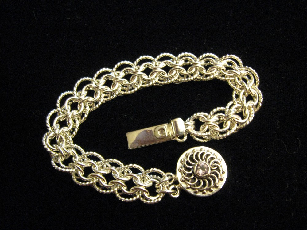 Cylon weave bracelet in twisted and smooth sterling silver wire with amethyst clasp