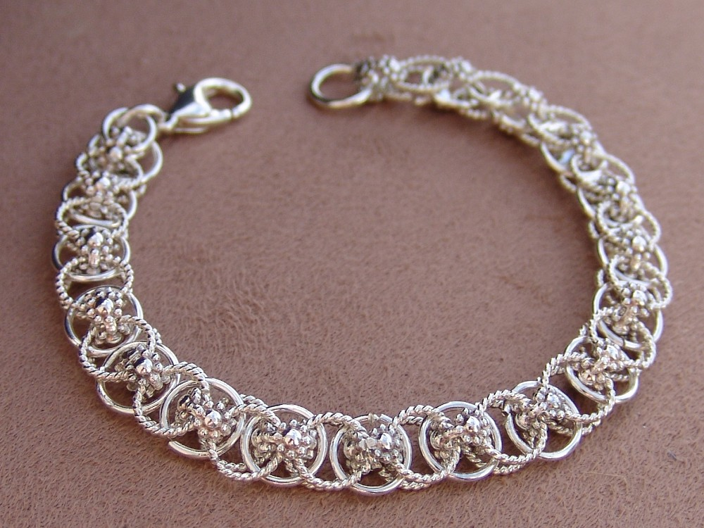 Sterling silver Celtic weave bracelet with berry wire connections
