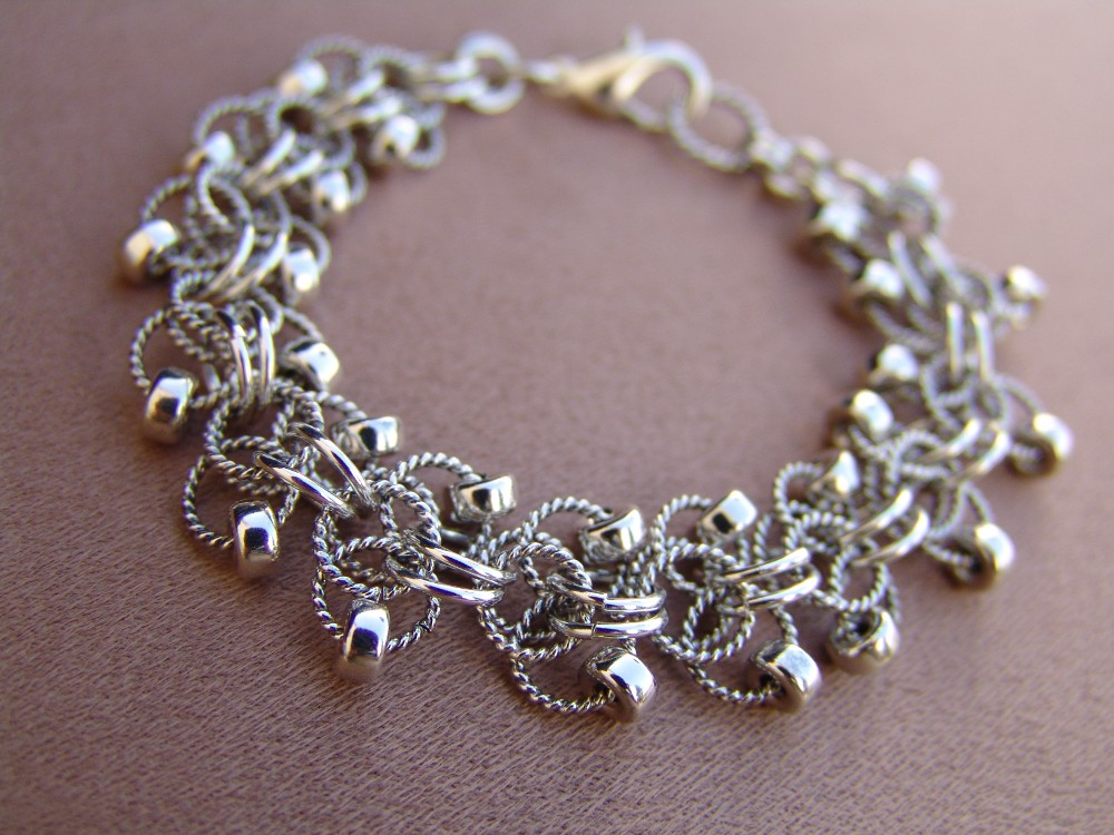 Roosa weave bracelet, with sterling silver beads and oxidized twisted wire